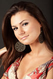 Beautiful brunette woman with earrings Stock Photo