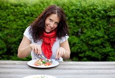 Beautiful Brunette Woman Eating a Salad Stock Photos