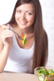 Beautiful brunette woman eating salad Royalty Free Stock Photography