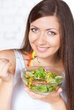 Beautiful brunette woman eating salad Stock Image