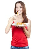 Beautiful brunette woman eating sushi Stock Photography