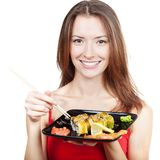 Beautiful brunette woman eating sushi Royalty Free Stock Image