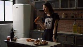 Lovely woman enjoying breakfast in the kitchen stock footage
