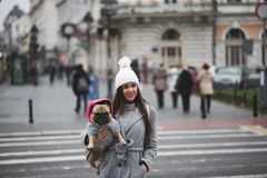 Beautiful girl with French bulldog stock image