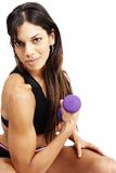 Beautiful brunette woman exercising. With a purple dum bell stock photo
