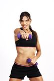Beautiful brunette woman exercising. With purple dumbbells stock image