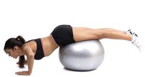 Beautiful brunette woman exercising Royalty Free Stock Image
