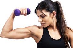 Beautiful brunette woman exercising Stock Image
