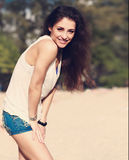 Beautiful brunette woman in fashion shorts and white top posing Royalty Free Stock Photos
