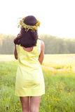 Beautiful brunette woman fashion style outdoors in yellow dress smiling happy concept idea to look into the distance Royalty Free Stock Photos