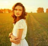 Beautiful brunette woman in field Stock Image