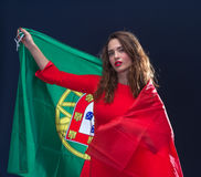 Beautiful brunette woman with Flag of Portugal. Toned image Stock Images