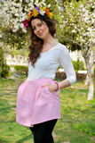 Beautiful brunette woman with flower wreath in the spring garden Royalty Free Stock Photos