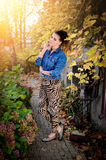 Beautiful brunette woman in garden Royalty Free Stock Photo