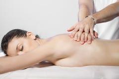 Beautiful brunette woman getting a massage Stock Photos