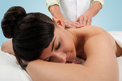 Beautiful brunette woman getting a massage at the spa Royalty Free Stock Photo
