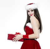 Beautiful brunette woman with gift - christmas portrait stock photo