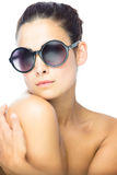 Beautiful brunette woman with gigantic round sunglasses Royalty Free Stock Image
