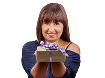 Beautiful brunette woman giving giftbox isolated Royalty Free Stock Photos