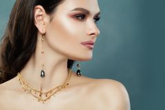 Beautiful Brunette Woman with Gold Jewelry stock image