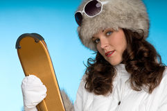 Beautiful brunette woman with golden skis Stock Photo