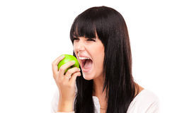 Beautiful brunette woman with green apple on white background Royalty Free Stock Photos