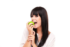 Beautiful brunette woman with green apple on white background Royalty Free Stock Photography