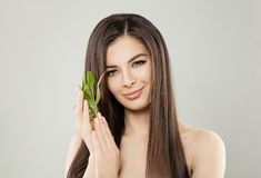 Beautiful Brunette Woman with Green Bamboo Leaves. On Banner Background Royalty Free Stock Photos