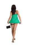 Beautiful brunette woman in green dress Stock Photos
