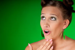 Beautiful brunette woman with green earrings Stock Photos