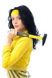 Beautiful brunette woman with a hammer Stock Photos