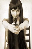 Beautiful brunette woman with handgun Stock Photo