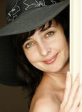 Beautiful brunette woman in hat Stock Photography