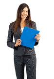 Beautiful Brunette Woman Holding A Clipboard Royalty Free Stock Images