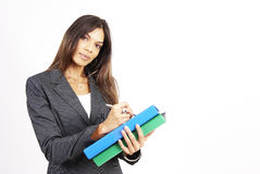 Beautiful Brunette Woman Holding A Clipboard Royalty Free Stock Photo