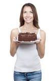 Beautiful brunette woman holding chocolate cake Royalty Free Stock Photo