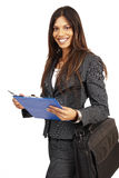 Beautiful brunette woman holding a clipboard Stock Photos