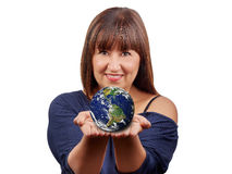 Beautiful brunette woman holding earth isolated Royalty Free Stock Image