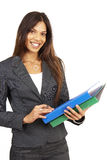 Beautiful brunette woman holding files Royalty Free Stock Photo