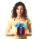 Beautiful brunette woman holding a gift. Stock Photography