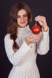 Beautiful brunette woman holding gift Toys Stock Photography