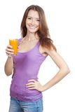 Beautiful brunette woman holding glass of juice Stock Images
