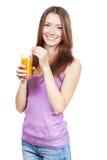 Beautiful brunette woman holding glass of juice Stock Photos