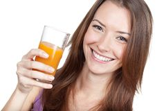 Beautiful brunette woman holding glass of juice Royalty Free Stock Images
