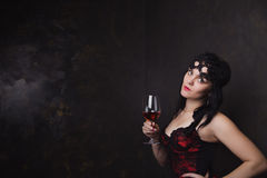 Beautiful brunette woman holding a glass of red wine Royalty Free Stock Image