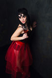 Beautiful brunette woman holding a glass of red wine Royalty Free Stock Images