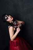 Beautiful brunette woman holding a glass of red wine Stock Image
