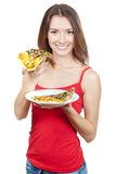 Beautiful brunette woman holding piece of pizza Stock Image