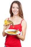 Beautiful brunette woman holding piece of pizza Royalty Free Stock Images