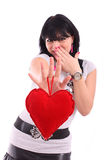 Beautiful brunette woman holding a red heart Stock Photography